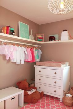 Baby Clothes as Room Decor - The wardrobe wall is such a lovely way to display some of your favorite outfits. #nursery