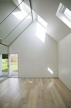 Copenhagen firm Svendborg Architects built this artist's studio inside an existing stable building in Denmark.