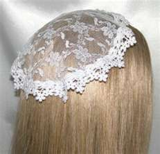Chapel Veil for church. Girls & women couldn't have their head uncovered if you were Catholic.