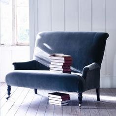 We'd love to curl up on this indigo velvet sofa with a good book...