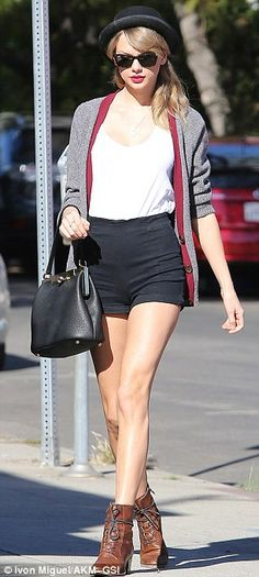 Taylor Swift shows off her long legs in a tiny black mini skirt