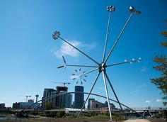 """One of the most visible landmarks on the island is """"Bloom"""", one of Calgary's newest pieces of public art by Montreal artist Michel de Broin. The piece is 23 metres-high, with working lights on many of its branches that illuminate its surroundings at night."""
