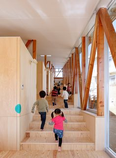Yamazaki Kentaro Design Workshop created stepped levels inside this nursery in Japan's Chiba Prefecture to form a large, open space across the sloping site