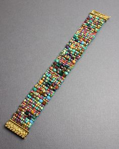 Intricately hand woven beaded bracelet. Beautiful shades of turquoise, blue, lime green, pink and purple, are loom woven with crystal bead to create this richly colorful bracelet. Truly a unique and one of a kind bracelet. Completely handmade by artisan jeweler Kathy Bankston in the USA.