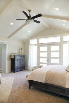 Four Chairs Furniture & Design Studio Great lighting for vaulted ceilings with exposed beams. Ceiling Fan Vaulted Ceiling, Vaulted Ceiling Bedroom, Vaulted Ceilings, Ceiling Ideas, Cathedral Ceiling Bedroom, House Ceiling, Cathedral Ceilings, Slanted Ceiling, Ceiling Lights