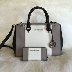 MK Color block sutton with wallet Authentic Michael Kors bag and matching wallet. Its medium sized sutton satchel in black white and grey color block. The hardware is silver. Will trade for another handbag/wallet set. Comes with sh Outlet Michael Kors, Cheap Michael Kors, Michael Kors Tote, Handbags Michael Kors, Mk Handbags, Luxury Handbags, Purses And Handbags, Ladies Handbags, Cheap Handbags