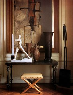 An eclectic arrangements that combines 40's sculpture with objet d'art. Yves Gastou's 9th arrondissement apartment.