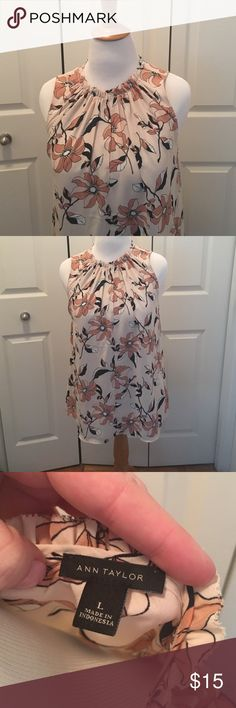 Ann Taylor sleeveless blouse.  Almost new. Ann Taylor sleeveless blouse with floral pattern. Worn 2-3 times but it's just not my colour.  Large.  Can wear open at the neck or closed. Ann Taylor Tops Blouses