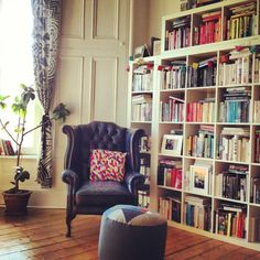 Living room. More gorgeous Glasgow tenement light and features. We piled loads of IKEA Expedit bookshelves together for the Wall O' Books (they're secured to the wall). Chair second-hand, footstool Fun Makes Good (Glasgow designer), bought from Welcome Home in the CCA.