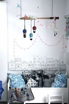 Love this room!! The cityscape against the wall, the mobile, the cushions - the whole thing: IT JUST WORKS!! Www.homeology.co.za