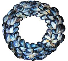 Mussel Wreath - Getting the mussels is as much fun as making the wreath! You can get them at the beach or eat a big bowl at your favorite restaurant and ask for a doggy bag… But please don't take live mussels just to make a wreath. http://blog.oceanofferings.com/category/crafts/page/3/