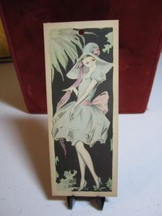 1920's flapper girl bridge tally card in pretty dress with matching hat unused. $8.00, via Etsy.