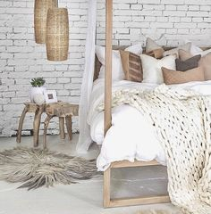 white brick • white bedding • wood • dream home bedroom • knit throw • fluffy accent • earth toned