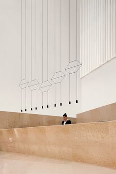 "enochliew: ""Wireflow by Arik Levy Configuration of wires and pendants create sculptures resembling line drawings from afar. """