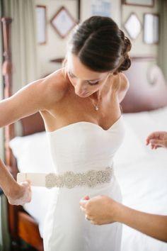 Bride getting ready (Nicole Miller Dakota wedding dress)