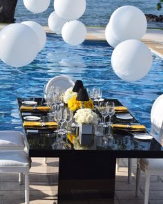 Black and yellow poolside. Good idea for your bridal shower or engagement party.