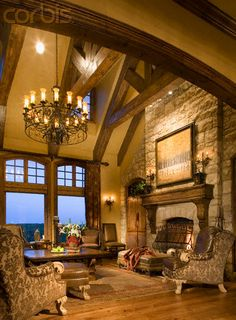 Stone Fireplace in Living Room, vaulted ceilings with the beams exposed in my future rach style inspired home located in Beecave, TX