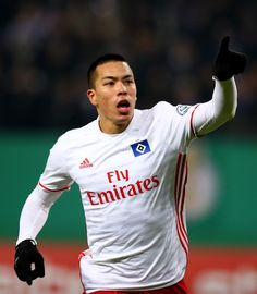 Bobby Wood of Hamburg celebrates after scoring the 2nd goal during the DFB Cup round of 16 match between  Hamburger SV and 1. FC Koeln at Volksparkstadion on February 7, 2017 in Hamburg, Germany.