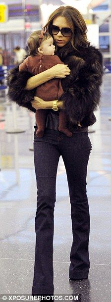 VB, world's most stylish mom. Her chronic use of stilettos is a revelation.