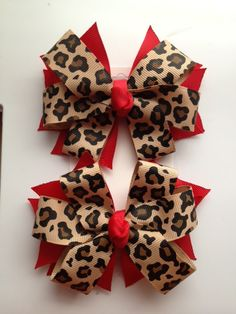 leopard printed ribbon  hair bow set  with red. $5.50, via Etsy.