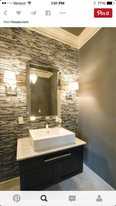 Amir bathroom.  Backsplash tiles with simple vanity and sink and mirror.  Home Depot tiles and paint on walls with crown molding uppers in white.  Floor a cheap basic white or gray ceramic tile or ceramic wood looking black tile
