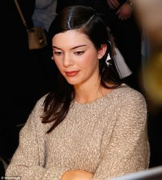 Bold looks: Kendall's long dark locks were styled in a dramatic side part for her appearan...