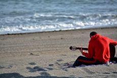 Play guitar on the beach