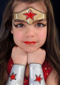 Turn your little girl into Wonder Woman with this awesome face painting. #DIY #costumes #facepainting