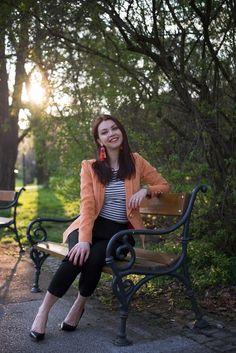Orange jacket, stripes t-shirt, black trousers, spring look
