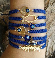 Items similar to gold fishbone/fish/flower/evil eye/star/ macrame bracelet on Etsy Bracelet Crafts, Macrame Bracelets, Jewelry Crafts, Hemp Jewelry, Macrame Jewelry, Marine Style, Beaded Anklets, Layered Jewelry, Homemade Jewelry
