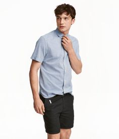 Light blue/texture-woven. Short-sleeved shirt in soft, woven cotton fabric with a button-down collar and one chest pocket. Regular fit.