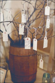tagged wedding wishes on tree branches...