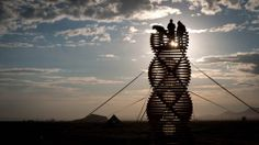 My inner kid is so excited to see this...and it was for Burning Man.  From the creatives minds of Erich Remash and Chris Thomas, Helix Spire is a temporary sculptural climbing tower that rises 25 feet above the ground.