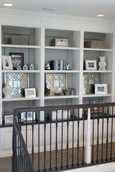 Simple bookcase display love the molding detail in the back with a washed finish -- House of Turquoise: Charlotte Hale of Plum Pretty Sugar - upstairs hallway Bookcase Styling, Built In Bookcase, Painted Bookshelves, Built In Wall Shelves, Stair Bookshelf, Painted Built Ins, Barrister Bookcase, Office Bookshelves, Bookshelf Organization