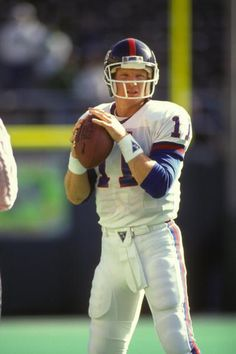 Phil Simms#11 of the New York Giants before a NFL football game against the Philadelphia Eagles on September 25 1990 at Veterans Stadium in...