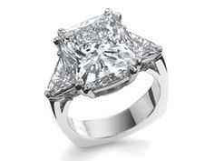 Precision Set 3 stone ring with cushion cut center and trillion sides. Available at Alson Jewelers.