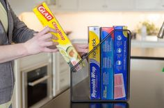 Keep foil, plastic wrap, and zip-bag boxes together in a magazine organizer.