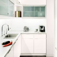 Image from http://housetohome.media.ipcdigital.co.uk/96/00001598c/7af1_orh550w550/All-white-small-kitchen.jpg.