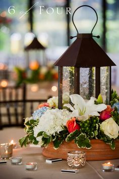 Great centerpiece with lanterns and flowers - 6 of Four Photography