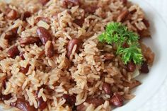 """The Haitian rice and beans Mmmmm…. What a delight! Among Haitians, they call this recipe """"riz cole ak pwa"""" (rice and beans).This rice is by far my favorite kind of rice; Haitian Food Recipes, Veg Recipes, Side Dish Recipes, Vegetarian Recipes, Cooking Recipes, Yummy Recipes, Chicken And Okra Recipe, Canned Beans Recipe, Hatian Food"""