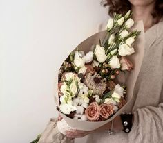 Protea bouquet with cappuccino roses and cotton