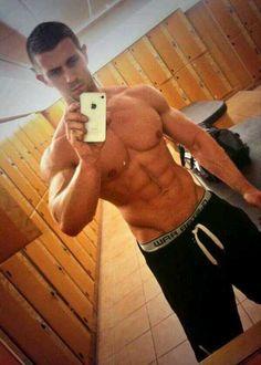Jacked shirtless locker room stud