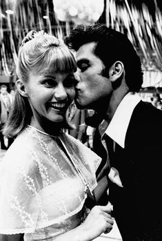 "Olivia Newton-John and John Travolta in character as ""Sandy Olsen"" and ""Danny Zuko"" in ""Grease"", 1978 John Travolta, Pulp Fiction, Movies And Series, Movies And Tv Shows, Grease Movie, Grease 1978, Sandy And Danny, Film Musical, Grease Is The Word"