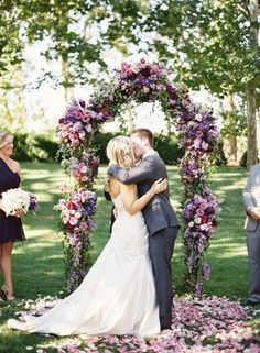 Outdoor ceremony under a violet archway at Bear Flag Farm; Photo by Jose Villa