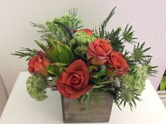 Coffee break roses,queen Anne's lace, Leucadendron, white thistle arranged in a 5x5
