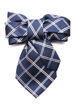 Made from a recycled necktie this bowtie brooch is bound to get tongues wagging. Wear it on your jacket, bag or for the fashion forward wear it on your shirt.6 1/2 wide7 1/2 long