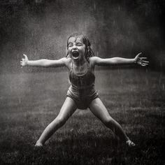 Nothin better than playing in the rain. photo Kate-T-Parker