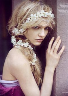 fresh garland of white, teamed with messy hair is so youthful and fresh (Vogue India)