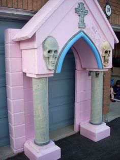Here's a couple construction pics and some shots of my mausoleum Halloween night. I only ended up getting the front entrance archway and pillars done and will be working away on the rest of the front facade and side wall/roof for 2011. I have more photos in my album or on my website.