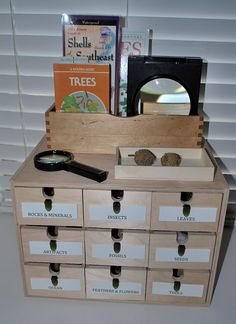 For science area: discovery box labels. Would be nicer with photos of materials for emergent readers.